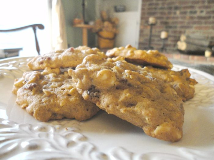 Pumpkin Monster Cookies - Fall pumpkin recipes HAVE to include these cookies! Made with real pumpkin puree, white chocolate, Craisins, rolled oats, and fall spices. Recipe on basilmomma.com