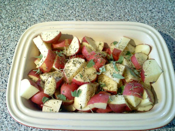 Herb roasted potatoes are a simple side dish, packed with flavor from fresh parsley, sage, rosemary, and thyme. Get the easy side dish recipe on basilmomma.com