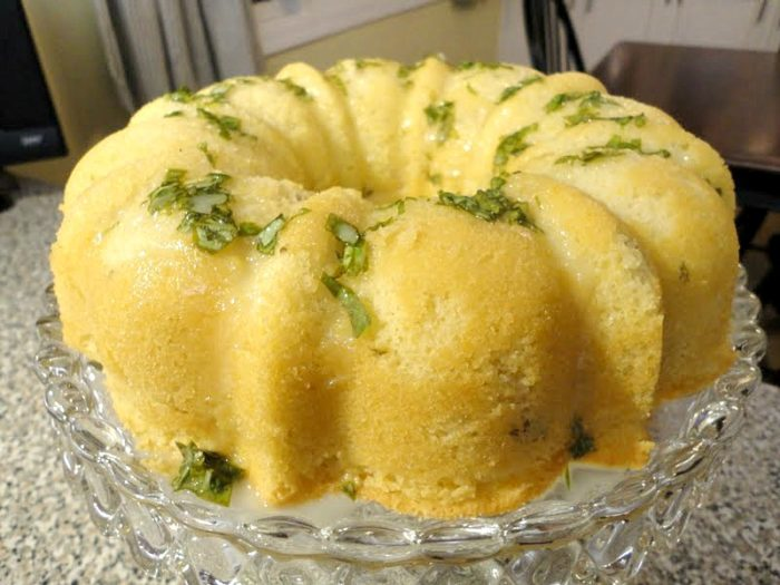 Pound cake with lemon basil glaze is the perfect cake recipe to make for a light, lemony summer dessert. The fresh basil adds great flavor and a nice visual aspect to the sugar glaze on top.