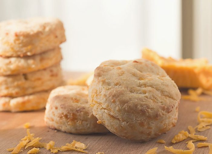 Making these flaky, cheesy, Cabot cheddar cream homemade biscuits takes just 30 minutes from start to finish!   basilmomma.com