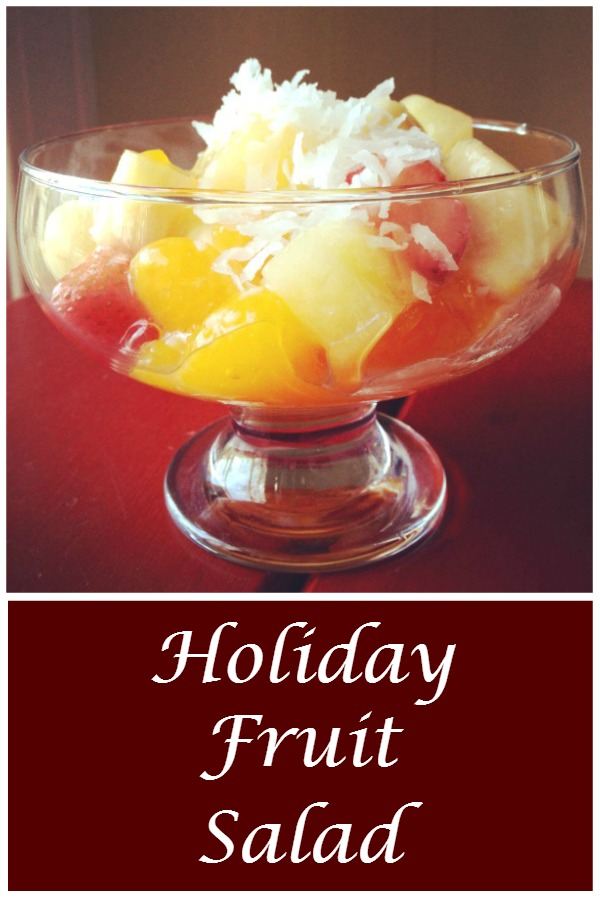 Holiday Fruit Salad Recipe - The perfect holiday side dish, this fresh fruit salad is a family favorite. Get the recipe from basilmomma.com - You won't believe what the secret ingredient in this holiday fruit salad is that keeps it from being too watery and PERFECTLY sweet, but not TOO sweet!
