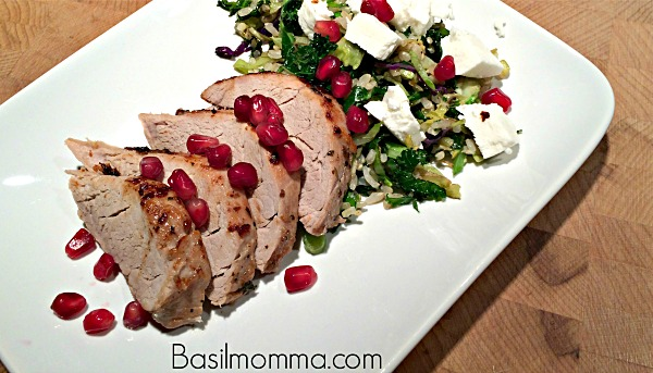 Marinated pork tenderloin recipe, prepared with a pomegranate vinaigrette marinade, served with pomegranate arils, goat cheese, and tender brown rice. Get the recipe on basilmomma.com