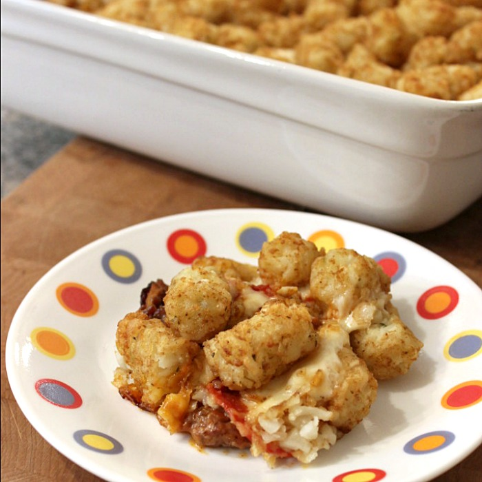 Pizza Tater Tot Casserole is a delicious and easy casserole recipe that kids and adults love! Your favorite pizza toppings baked with crispy tater tots on top.