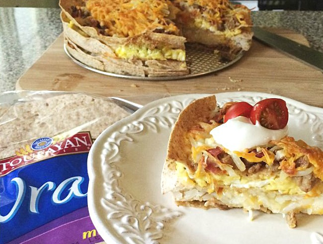 Breakfast Lasagna- Move over bacon, eggs and potatoes! Layer Toufayan Bakeries multi-grain wraps, eggs, bacon, sausage, potatoes, and cheese for a healthy and hearty breakfast! - Get the recipe on basilmomma.com
