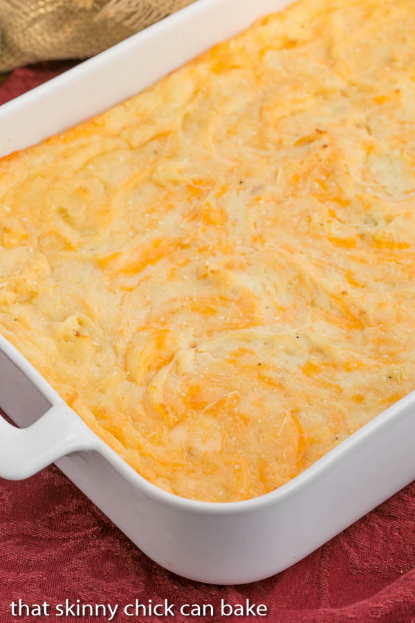 Cheesy Mashed Potato Casserole - A delicious twist on basic mashed potatoes. Get this easy side dish recipe on basilmomma.com