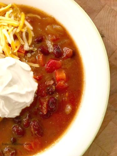 Slow Cooker Black Bean Pumpkin Chili - a hearty, vegetarian chili and the perfect fall comfort food! Recipe on basilmomma.com