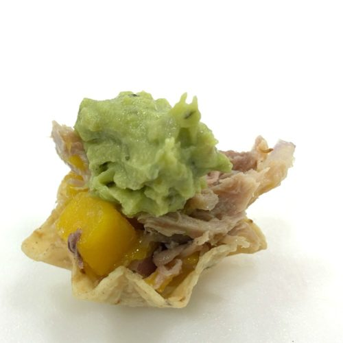 Mango duck mini tostadas are a quick, easy, and flavorful appetizer for any occasion. Fresh mango, shredded duck breast, red onion and spices sit in bite sized corn tortilla cups with fresh guacamole. | Basilmomma.com