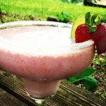 Fizzy Strawberry Margaritas in a margarita glass. Get the recipe on basilmomma.com