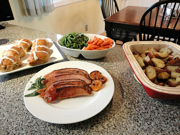 Complete Easter dinner, including tangerine glazed ham, garlic green beans, herb roasted potatoes, and hot cross buns.