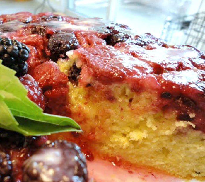 slice of mixed berry upside down cornmeal cake