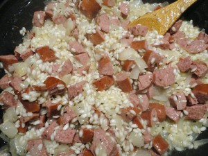 Sausage risotto recipe, cooking in a pan