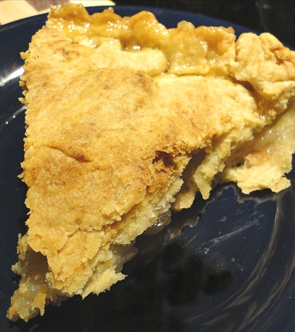 Country Apple Pie Recipe - Tender, spiced apples and a flaky, buttery crust. Get the classic dessert recipe on basilmomma.com
