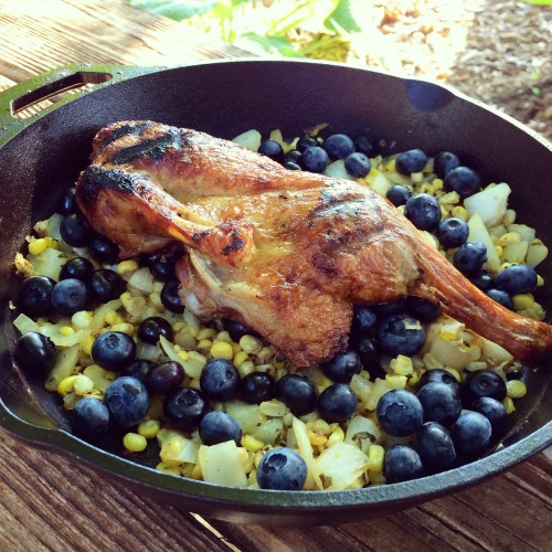 Grilled Duck with bacon, sweet corn, and blueberries