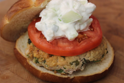 Turkey Burger Recipe, with spinach, Feta cheese, hummus, and a creamy cucumber topping. Get this healthy dinner recipe at basilmomma.com