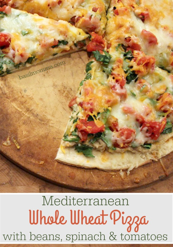 Mediterranean Whole Wheat Pizza with White Beans, Spinach, and Tomatoes - a delicioius meal full of cancer fighting foods! Get the recipe on basilmomma.com