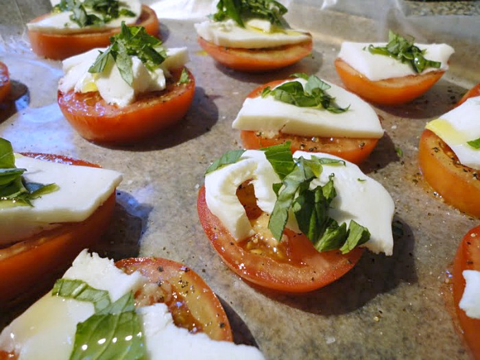 garden tomatoes, fresh basil, and soft mozzarella cheese make a delicious baked caprese appetizer
